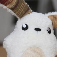 Closeup of one of the little plush bunnies we handmade. Design by UrbanThreads