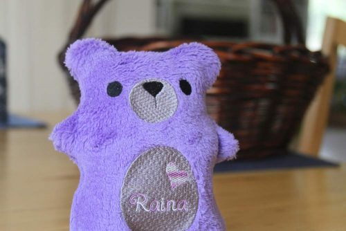I stitch and personalize the teddy bear